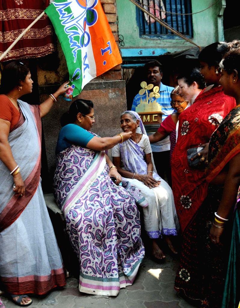 Mala Roy, TMC candidate campaigning for Kolkata Municipal Election in Kolkata on March 22, 2015. - Mala Roy