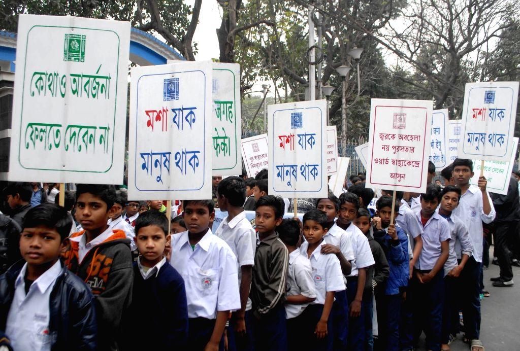 Kolkata Mayor Firhad Hakim with others participate in a Dengue awareness rally in Kolkata on Feb 08, 2020.