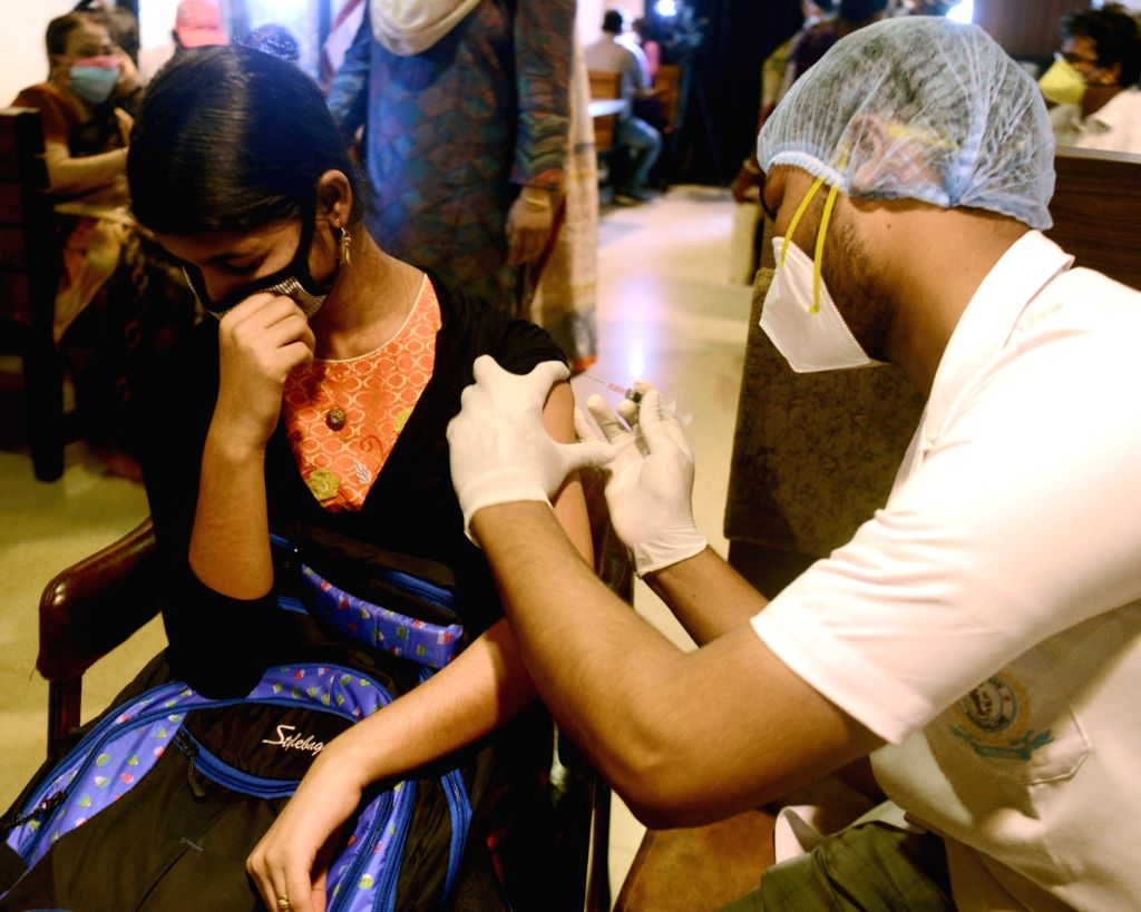 Kolkata:  Medics administer the first dose of COVID-19 vaccine to a specially-abled person during a vaccination drive  in Kolkata on Sunday 13 June, 2021. (Photo: Kuntal Chakrabarty/ IANS)