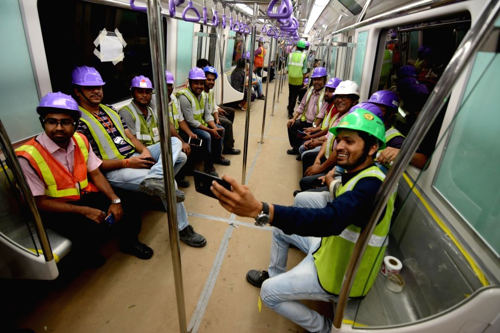 Kolkata Metro Rail Corporation (KMRC) Staff poses for selfies during the first underground trial run for East-West Metro corridor between Sector V and Phoolbagan metro stations in Kolkata, ...