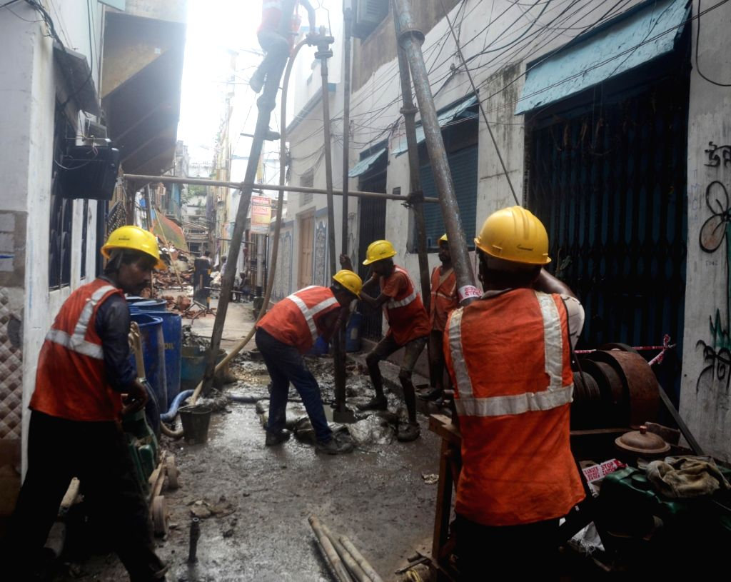 Kolkata Metro workers carry out repair works of houses damaged in the underground tunnelling work for the East-West Metro Project at Bowbazar area in Kolkata, on Sep 14, 2019.