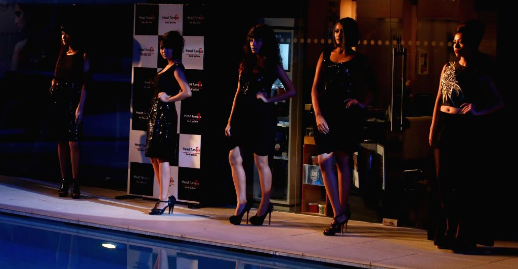 Models at the launch of a salon in Kolkata, on Dec 2, 2014.