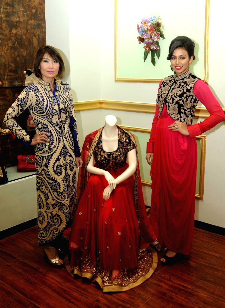 Models Nina Saxer and Sonika Chauhan during a programme organised to celebrates 1st Anniversary of their flagship store in Kolkata, on April 4, 2015.