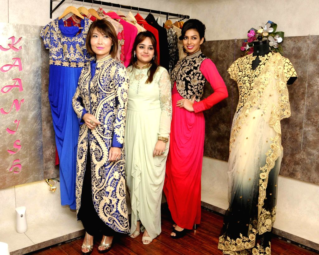 Models Nina Saxer and Sonika Chauhan with Designer Kainat during a programme organised to celebrates 1st Anniversary of their flagship store in Kolkata, on April 4, 2015.