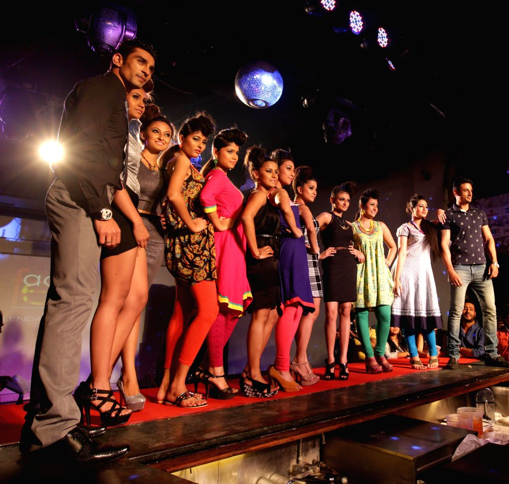 Models walk the ramp at the launch of `FFACE Calendar 2015` in Kolkata, on March 12, 2015.
