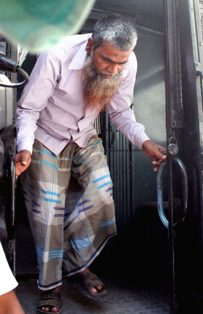 Mufazzil Haque, who was arrested in connection with the Oct 2 Burdwan blast being taken to be produced at a Kolkata Court on March 13, 2015.