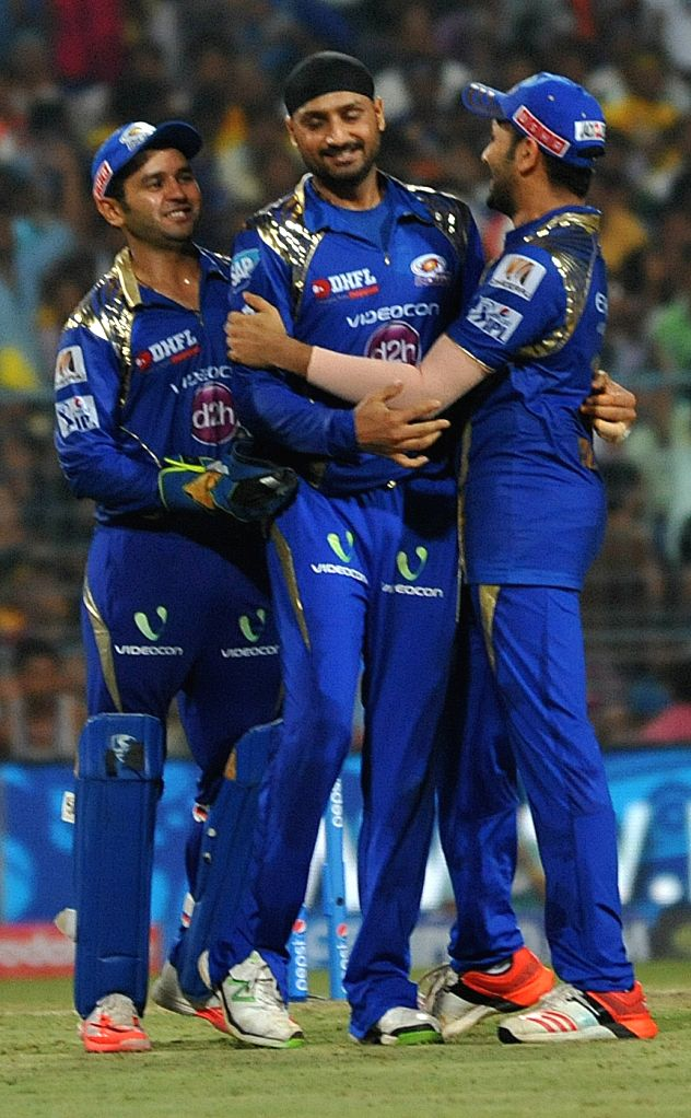 Mumbai Indians celebrate fall of a wicket during the final match of IPL 2015 between Mumbai Indians and Chennai Super Kings at the Eden Gardens in Kolkata, on May 24, 2015.