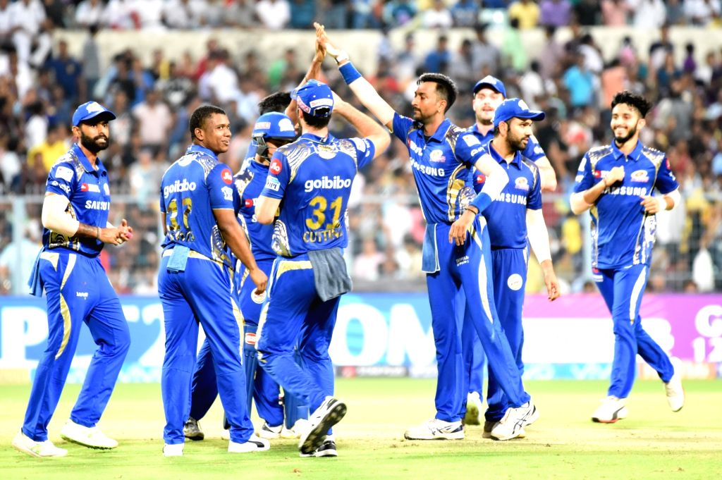 Kolkata:  Mumbai Indians celebrate fall of a wicket during an IPL 2018 match between Mumbai Indians and Kolkata Knight Riders at Eden Gardens in Kolkata on May 9, 2018. (Photo: Kuntal Chakrabarty/IANS)