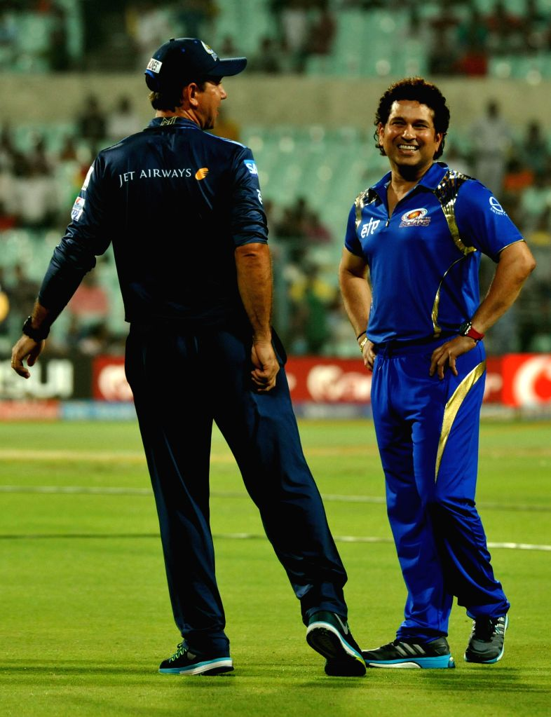 Mumbai Indians (MI) head coach Ricky Ponting with team's icon Sachin Tendulkar at the Eden Gardens in Kolkata, on April 8, 2015.