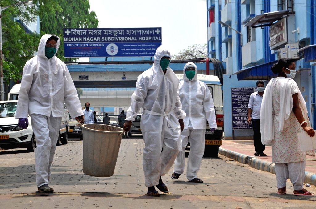 Kolkata: Municipal workers wear Personal Protective Equipment (PPE) suits as they dispose off medical waste during the extended nationwide lockdown imposed to mitigate the spread of coronavirus pandemic, in Kolkata on Apr 16, 2020. (Photo: Kuntal Cha