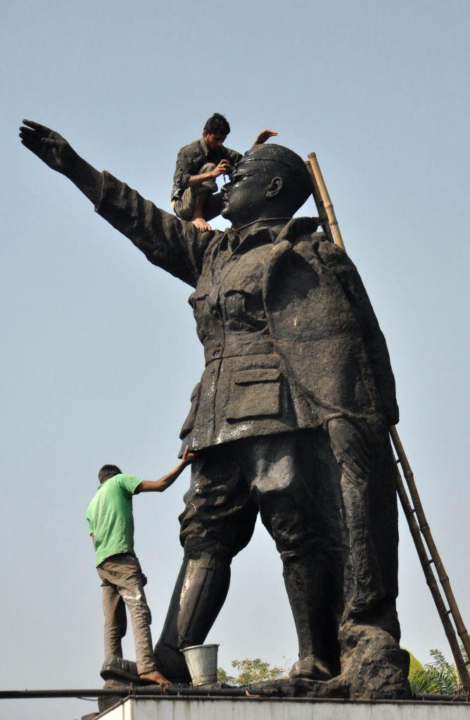 Netaji Subhash Chandra Bose's statue being cleaned on the eve of his birth anniversary in Kolkata, on Jan 21, 2015.