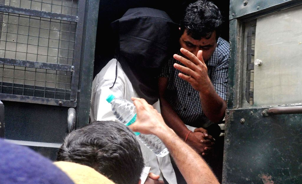 Nurul Hoque alias Naeem an alleged Jamat-ul-Mujahideen (JMB) trainer and motivator being produced before a court by NIA officials in connection with the Burdwan blast case in Kolkata on June ...