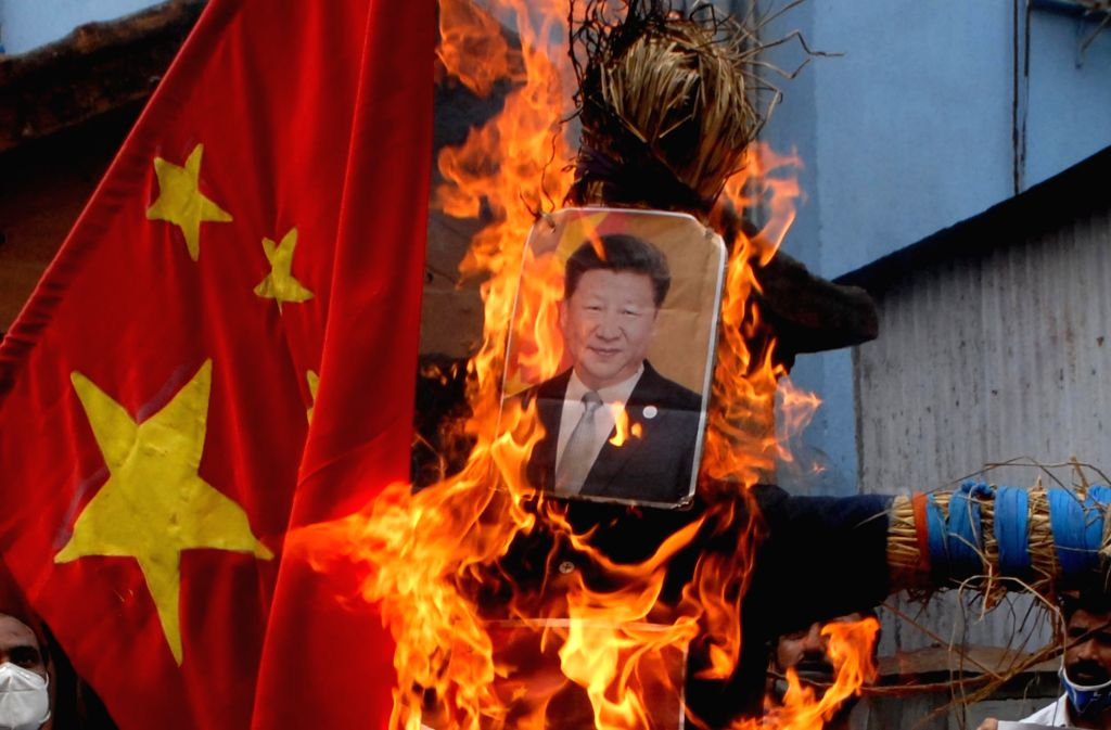 Kolkata: People burn an effigy of Chinese President Xi Jinping as they stage a demonstration against China over the brutal attack on Indian Army personnel at Galwan valley at the Line of Actual Control that has killed 20 Indian soldiers during the In