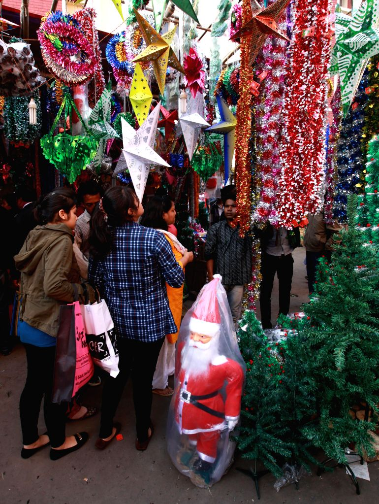 People busy with Christmas shopping in Kolkata, on Dec 23, 2014.