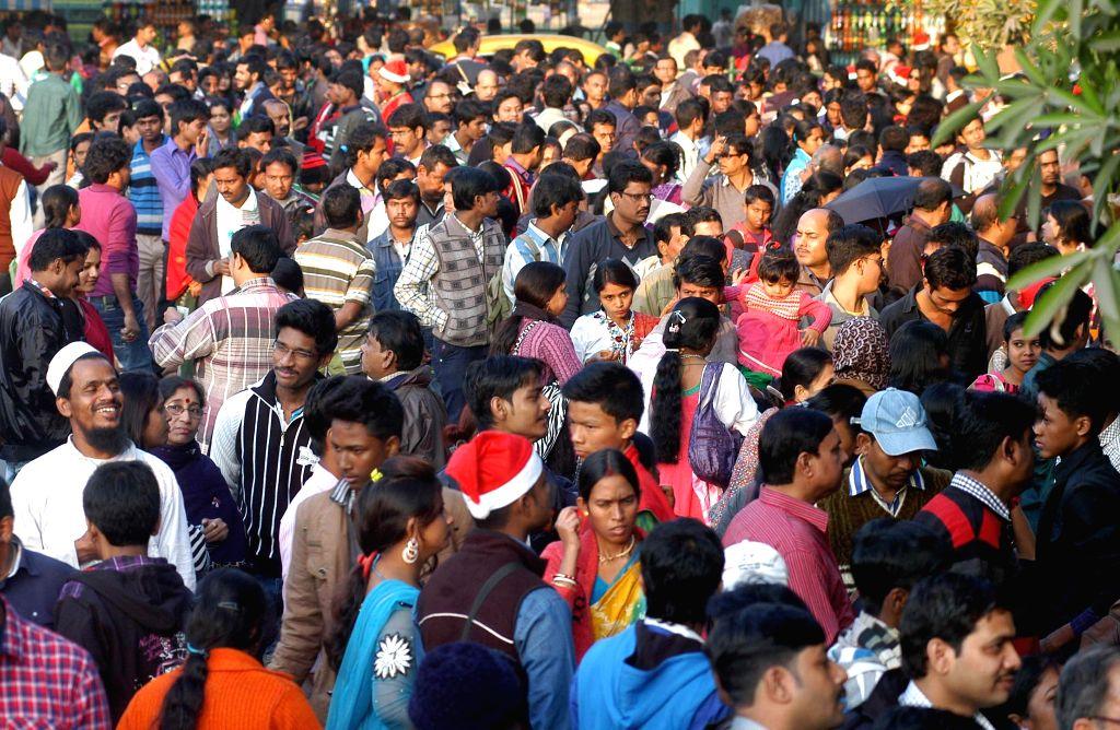 People celebrate Christmas at Maidan in Kolkata, on Dec 25, 2014.
