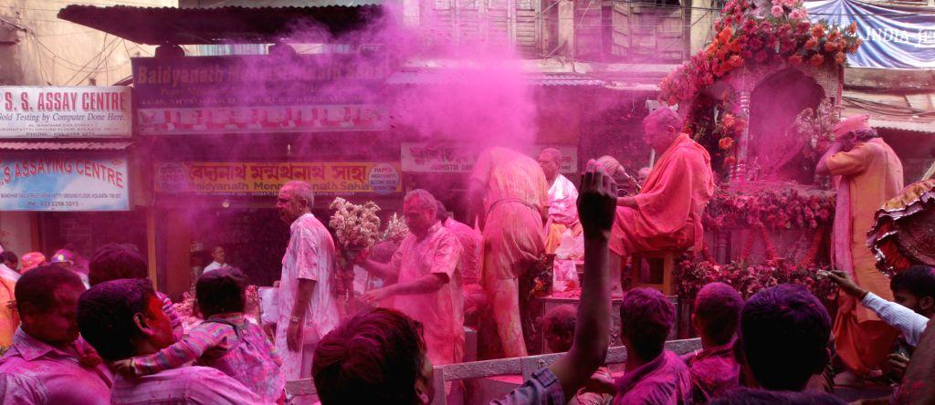 People celebrate `Holi` in Kolkata on March 4, 2015.