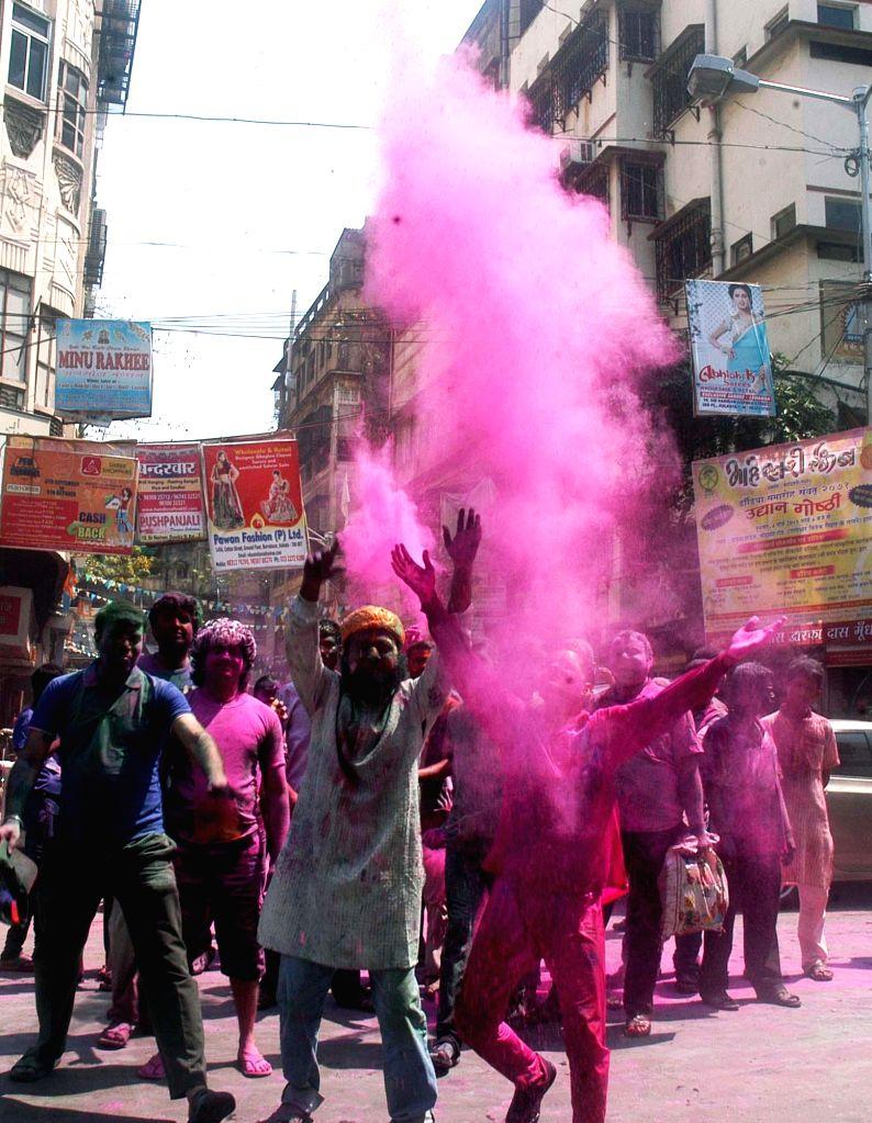People celebrate holi on the streets of Kolkata on March 6, 2015.