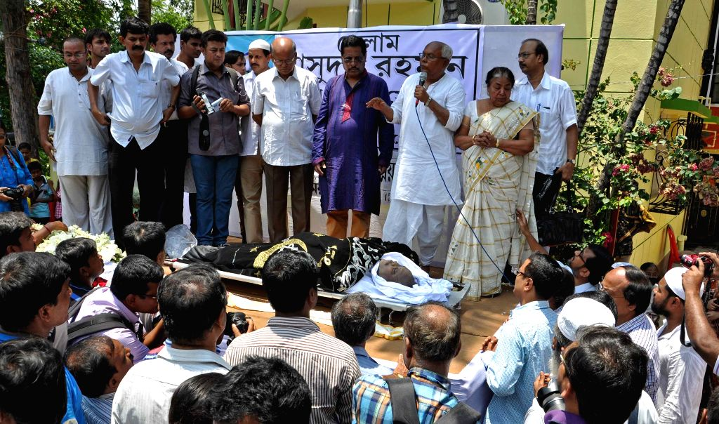 People gather at the funeral of Indian double-leg-amputee swimmer Masudur Rahman Baidya, who created a sensation by crossing the English Channel 18 years ago, in Kolkata on April 27, 2015. ...