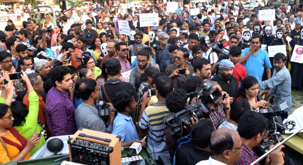 "Kolkata: People participate in a rally organised to protest against the withdrawal of Anik Dutta's film ""Bhobishyoter Bhoot (Ghost of the Future)"" from almost all multiplexes and single-screen halls in West Bengal, in Kolkata on March 10, 2019. (Phot"