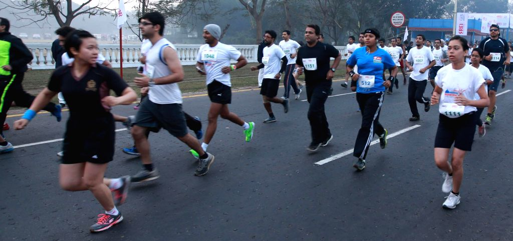 People participate in Kolkata Marathon 2015 (15 km) at Red Road in Kolkata, on Feb 8, 2015.