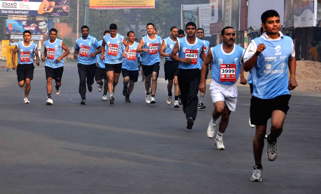 People participate in 'Run for Education' - a marathon organised in  Kolkata, on Nov 30, 2014.