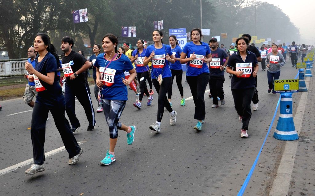 Kolkata: People participate in Tata Steel Kolkata 25K run in Kolkata on Dec 20, 2015. (Photo: Kuntal Chakrabarty/IANS)