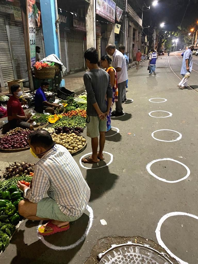 Kolkata: People practise social distancing while purchasing vegetables from a streetside greengrocery market during a complete lockdown for 21 days announced by Prime Minister Narendra Modi to prevent further spreading of the COVID 19 pandemic in Ind - Narendra Modi