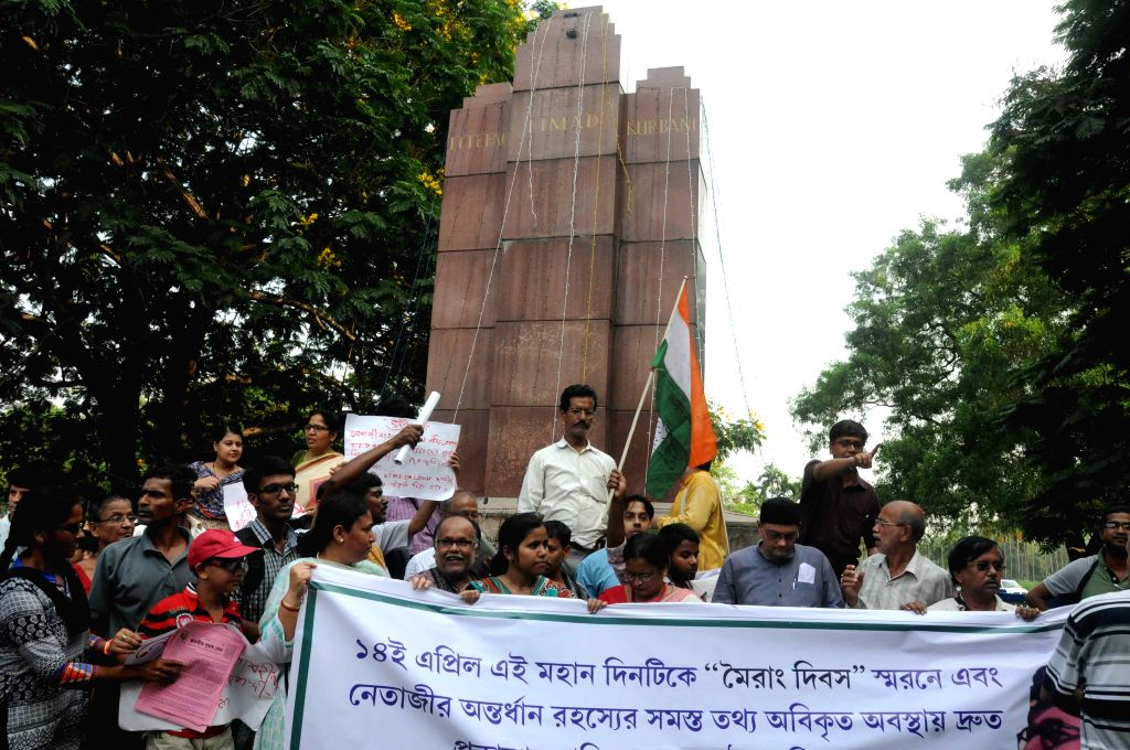 People stage a demonstration at the INA Memorial to demand declassification of documents related to Netaji Subhash Chandra Bose in Kolkata on April 14, 2015.