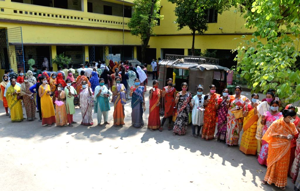 Kolkata: People stand in a queue at a polling station to cast their vote during the 5th phase of West Bengal's State Assembly elections at Barasat in North 24 Parganas on Saturday, 17th April, 2021.(Photo:IANS)