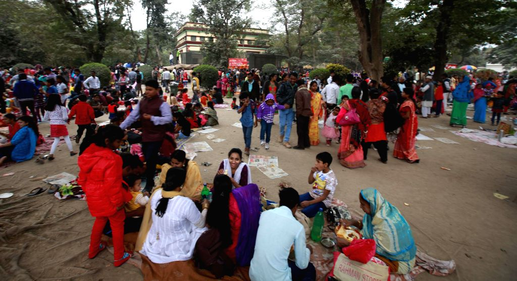 People throng Alipore Zoological Gardens in Kolkata on Jan 1, 2015.