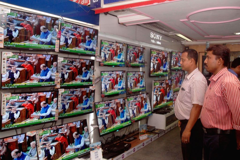 People watch Union Finance Minister Arun Jaitley present national budget 2015-16 on television sets in an electronics showroom of Kolkata, on Feb 28, 2015. - Arun Jaitley