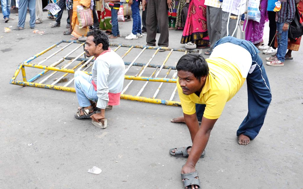 Physically handicapped people participate in a law violation programme against West Bengal Government in Kolkata, on April 6, 2015.
