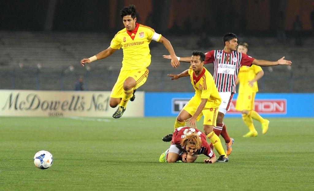 Players in action during an I-League match between Mohun Bagan and Pune FC at Salt Lake Stadium in Kolkata on Feb. 7, 2015. Mohun Bagan won. Score: 1-0.