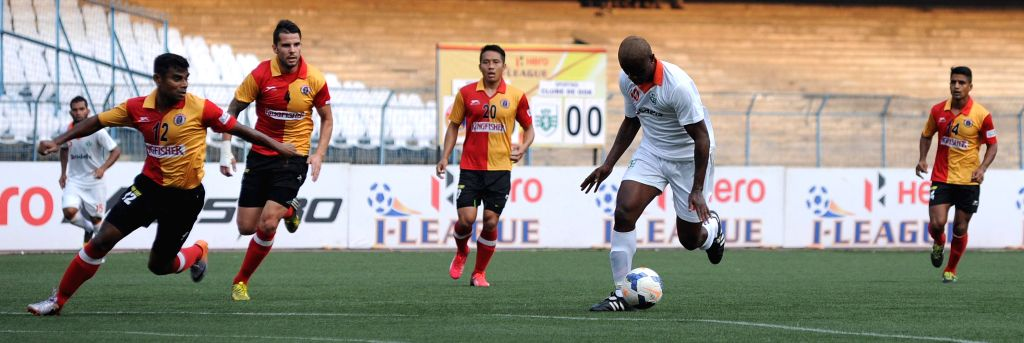 Players in action during an I-League match between East Bengal F.C. and Sporting Clube de Goa in Kolkata, on March 21, 2015. Score: 2-2.