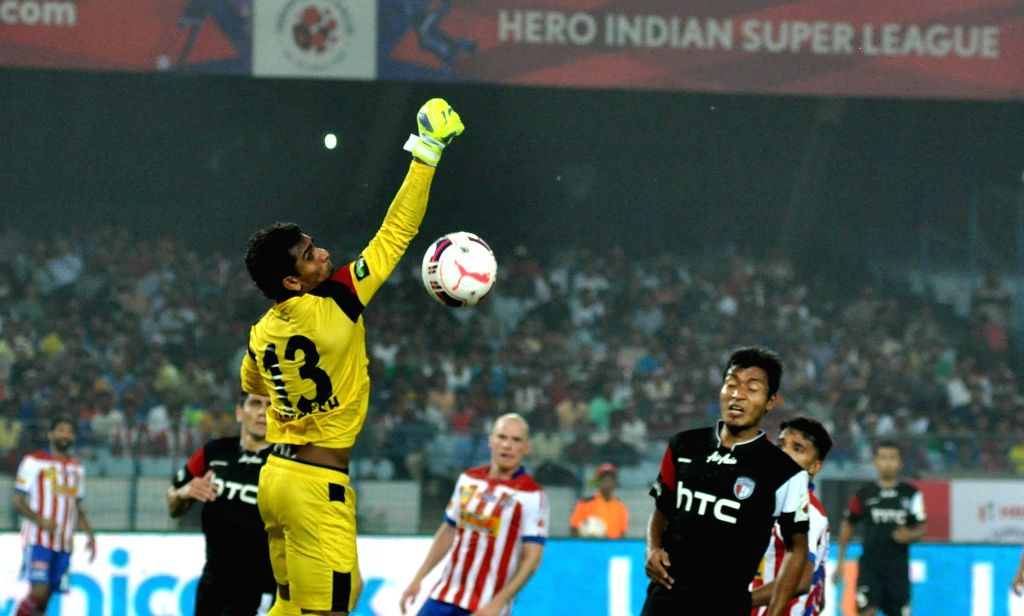 : Kolkata: Players in action during an ISL match between Atletico de Kolkata and NorthEast United FC in Kolkata on Nov. 7, 2015. .
