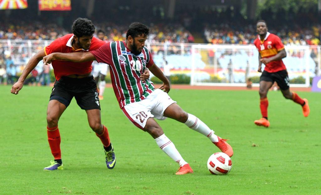 Kolkata: Players in action during Calcutta Football League Premier Division match between Mohun Bagan and East Bengal at Salt Lake Stadium in Kolkata on Sept 1, 2019. (Photo: IANS)