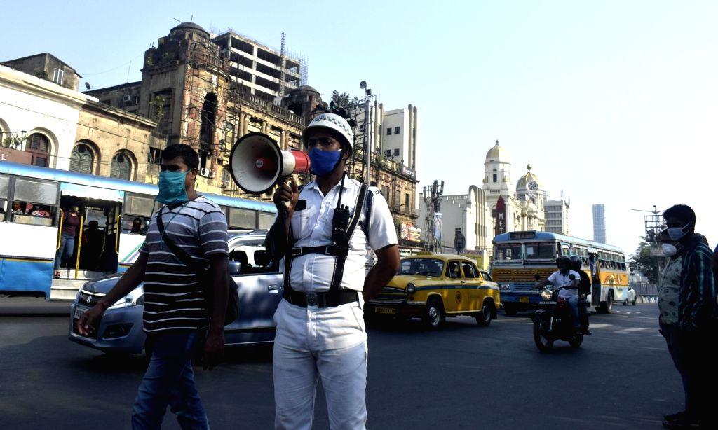 Kolkata police  bringing awareness to people against Covid 19 during the increasing numbers of COVID 19 patients in Kolkata .