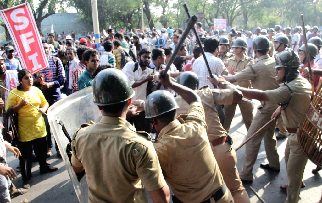 Police charge lathis on SFI activists demonstrating against West Bengal Government in Kolkata, on April 2, 2015.
