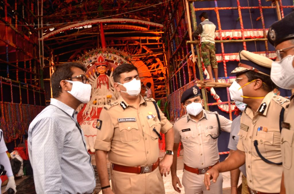 Kolkata Police Commissioner Anuj Sharma with his team visited Suruchi Sangha Durga Puja pandal to inspect preparations for precautions against COVID 19 ahead of Durga Puja celebrations amid ...