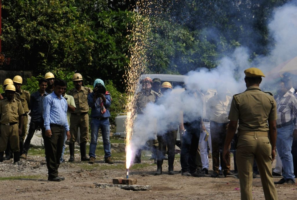 Kolkata Police officials check the noise level of crackers in Kolkata on Oct 18, 2016.