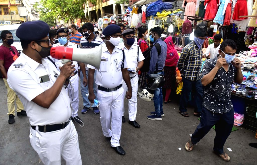 Kolkata Police personnel aware people for wearing masks and campaign against coronavirus at New Market area in Kolkata on April 14, 2021.