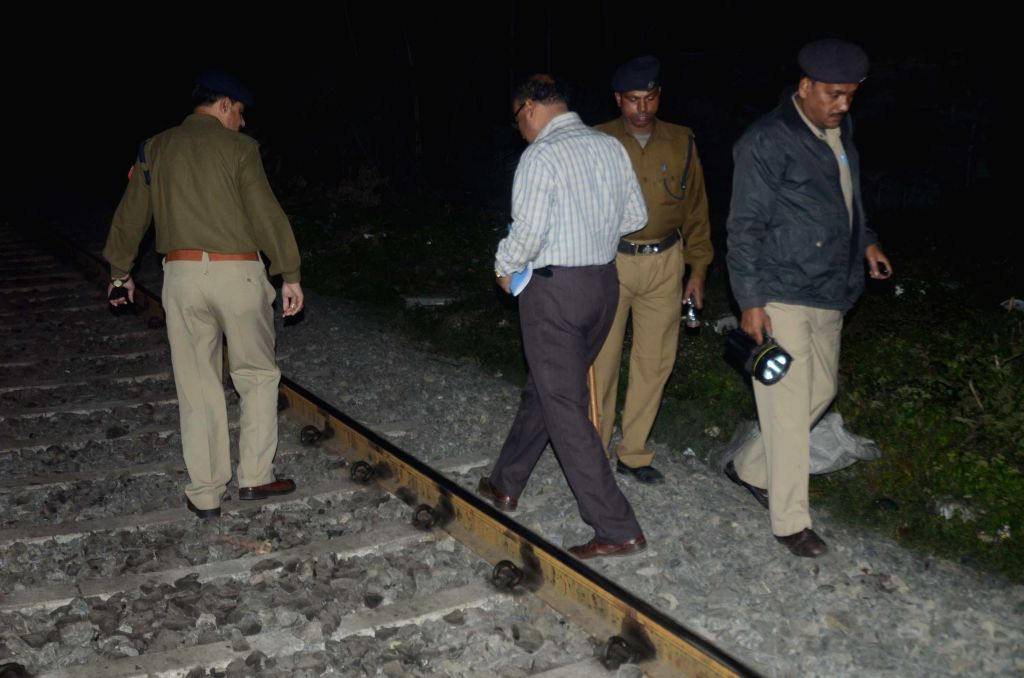 Police personnel carry out investigations at the site where two minors were injured after a crude bomb exploded near Dumdum railway station on the outskirts of Kolkata on Jan 10, 2015.