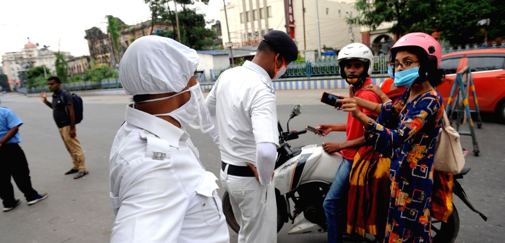 Kolkata : Police personnel intercept commuters at Esplanade during the biweekly COVID-19 lockdown in Kolkata on Aug 31, 2020.