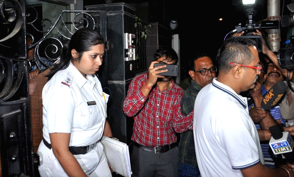 Kolkata Police personnel leave after conducting raids at one of the two properties of a company allegedly linked to former interim CBI director M Nageswara Rao in Kolkata on Feb 8, 2019. - M Nageswara Rao