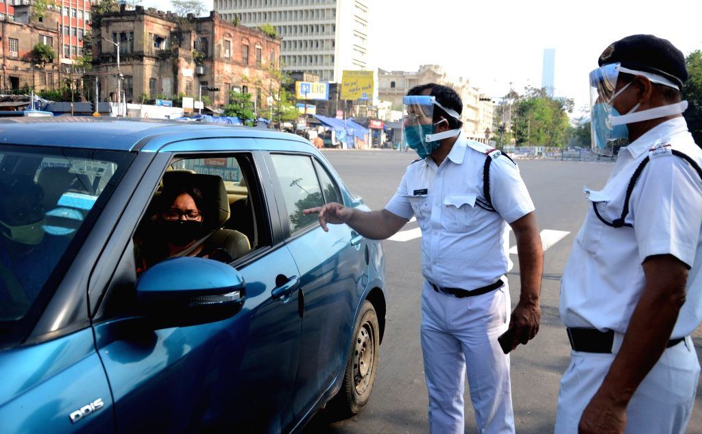 Kolkata: Police personnel wearing protective face mask while checking vehicles during the nationwide during the nationwide lockdown announced by Prime Minister Narendra Modi as a precautionary measure to contain the spread of COVID-19, in Kolkata on  - Narendra Modi