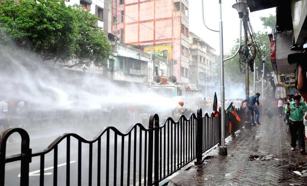 Kolkata: Police uses water cannons to disperse BJP activists staging a protest march against the killing of its party men in West Bengal, from Lalbazar to Kolkata Police Headquarters on June 12, 2019. (Photo: Kuntal Chakrabarty/IANS)