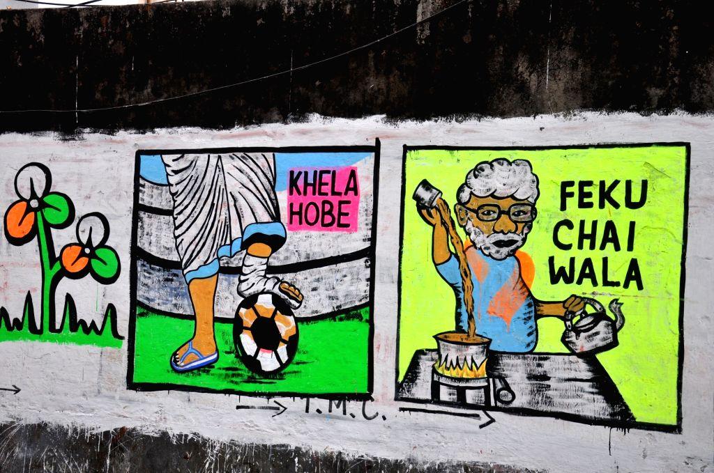 Kolkata: Political wall graffiti during State Assembly election in Kolkata. on April 16, 2021. (Photo: Kuntal Chakrabarty/IANS)