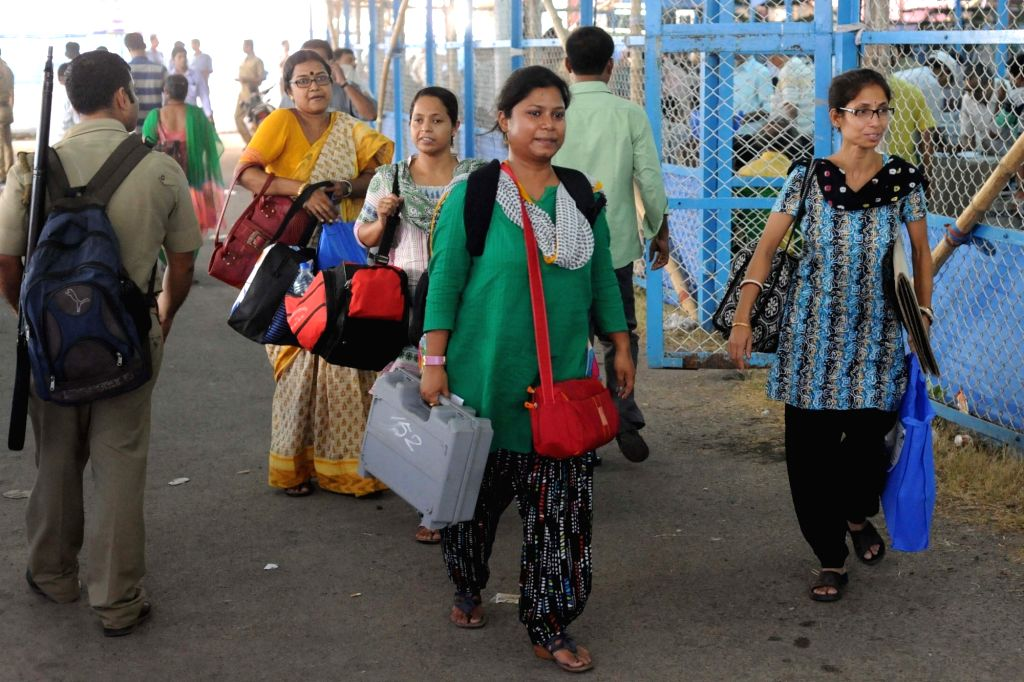 Kolkata: Polling personnel at an EVM and election material distribution centre ahead of West Bengal Assembly polls in Kolkata on April 29, 2016. (Photo: IANS)