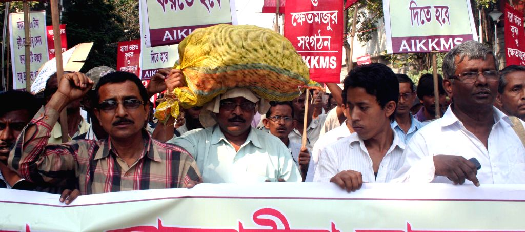 Potato farmers participate in a demonstration against the West Bengal Government as well as the Central Government in Kolkata, on March 20, 2015.