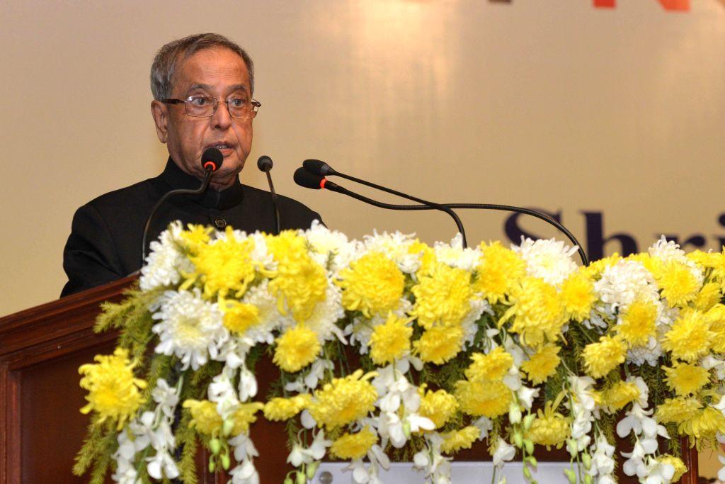 President Pranab Mukherjee at the inauguration of the Institute of Neurosciences in Kolkata on Nov 28, 2014. Also seen West Bengal Governor Keshari Nath Tripathi. - Pranab Mukherjee and Keshari Nath Tripathi